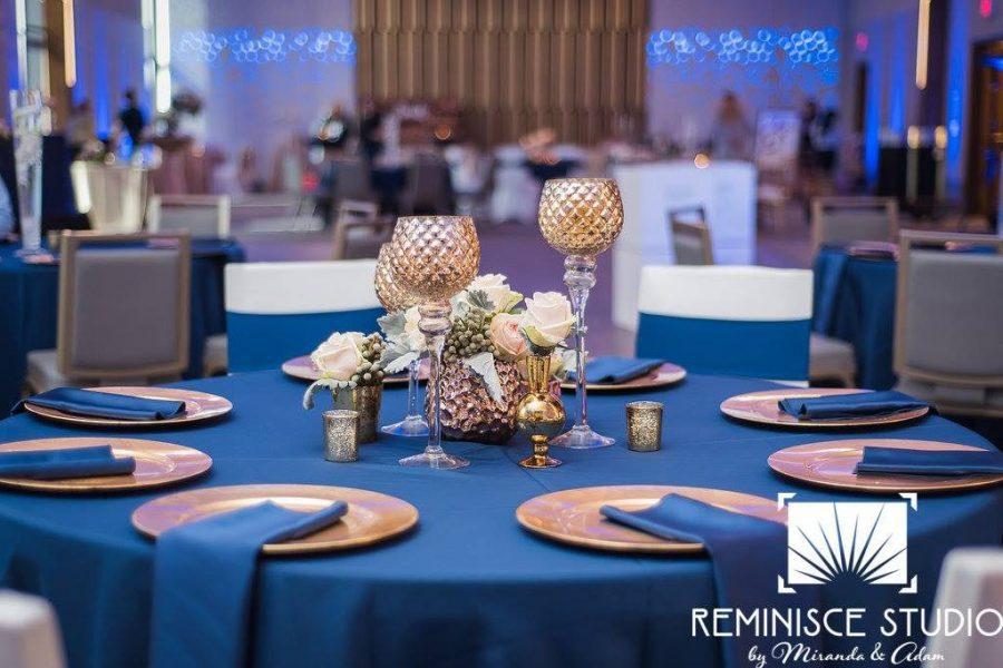 Elegant wedding reception at War Memorial Center in Milwaukee with royal blue linen