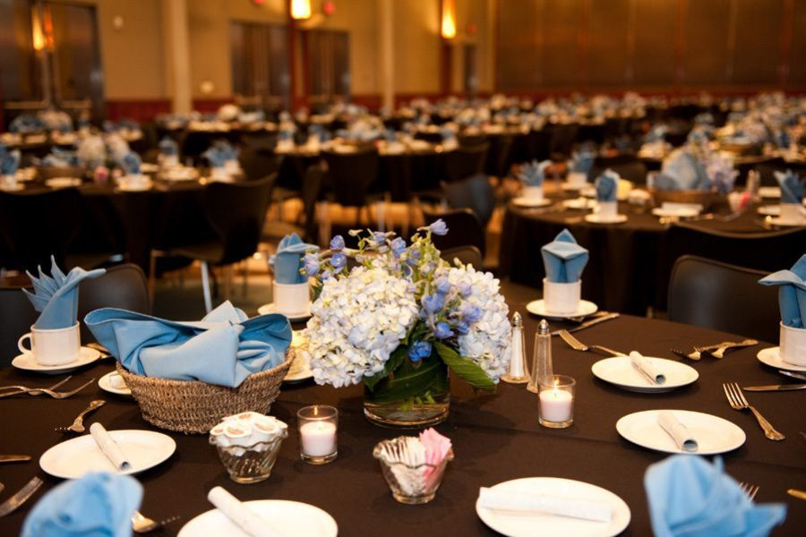 Wedding reception in brown and blue color scheme at the War Memorial Center