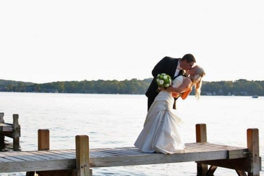 Groom & groom kiss on poier at Seven Seas on the east shore of Nagawicka Lake