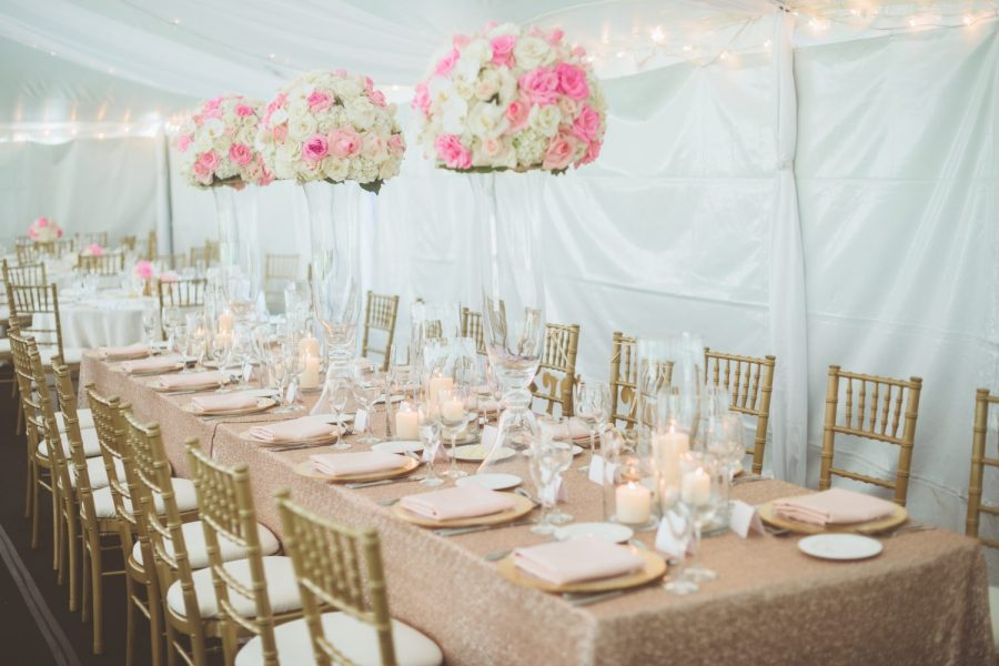 Tented wedding with gold Chiavari chairs and pale peach linens- Rentals by Well Dressed Tables