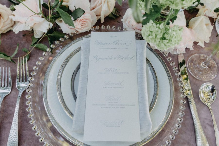 Place setting with menu card- Chargers, flatware, and china from Well Dressed Tables