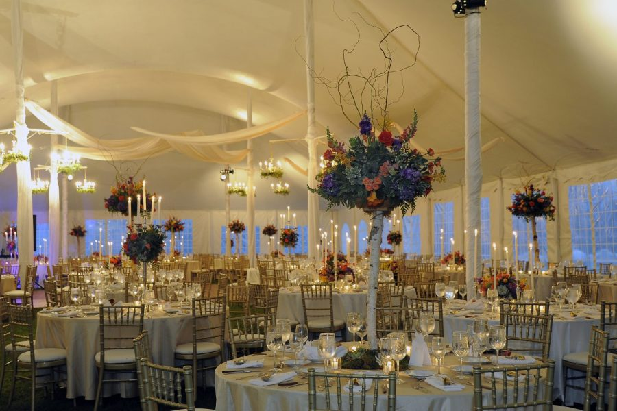 Tented wedding reception with chiavari chairs and all floral centerpieces