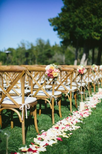 Outdoor wedding ceremony with wooden farm chairs with Beechwood finish and seat cushion- Well Dressed Tables