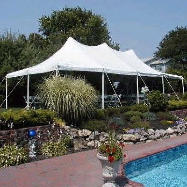 Celebrations Tent & Party Rentals- White event tent near swimming pool
