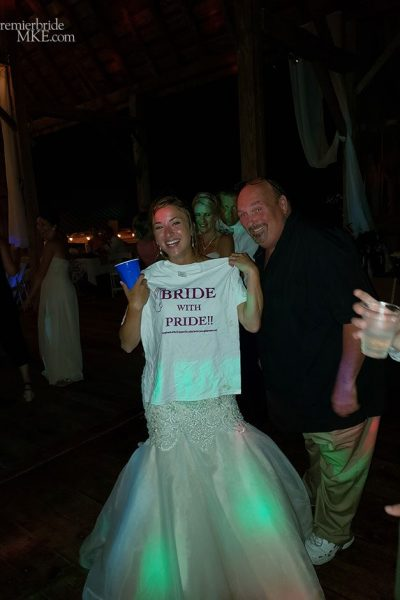 Bride holding up a special T-Shirt