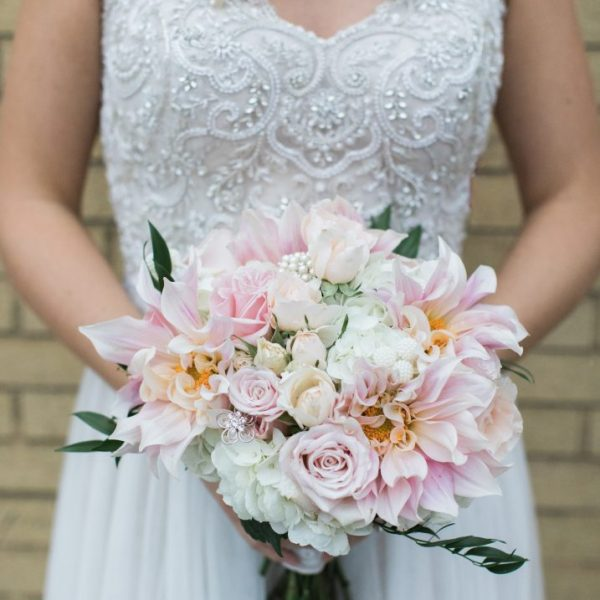 Soft colors make up this bouquet by Alfa Flower & Wedding Shop