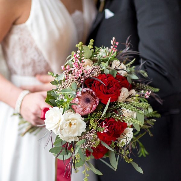 Rich colors abound in this beautiful bouquet by Alfa Flower & Wedding Shop