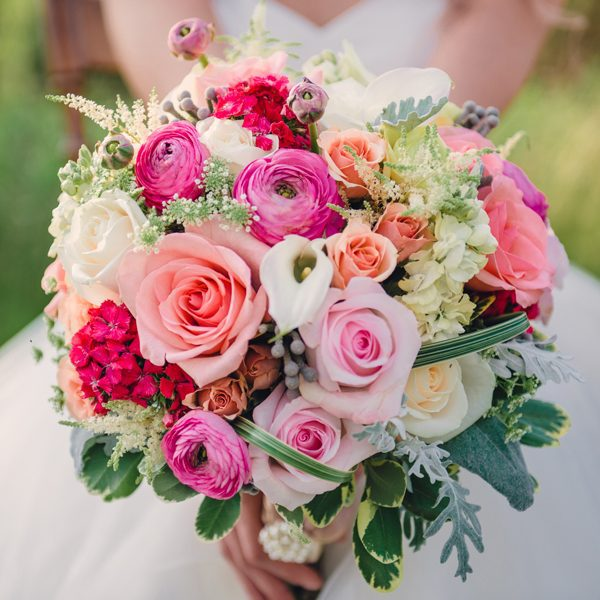This bouquet by Alfa Flower & Wedding Shop is pretty in pink