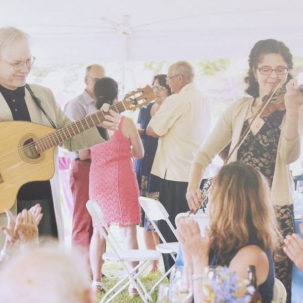 String group playing outside at a wedding reception
