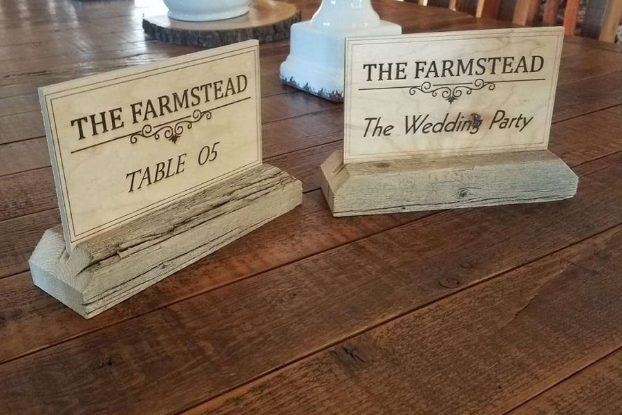 Wooden carved table number signs from the Farmstead
