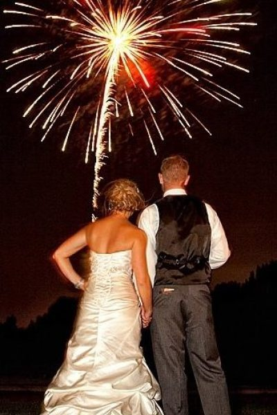 Back of wedding couple watching their fireworks
