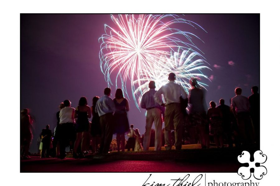 wedding guests enjoying a fireworks display at wedding reception