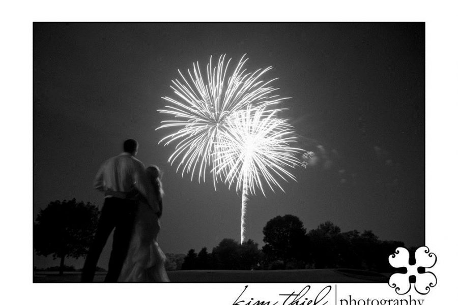 black and white photo of couple enjoying fireworks