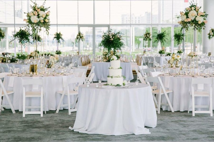 Wedding reception in white at Bartolotta Events & Catering at Discovery World