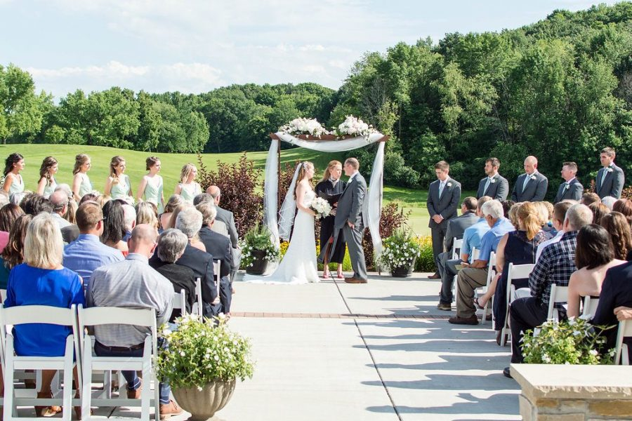 Outside wedding ceremony overlooking golf course