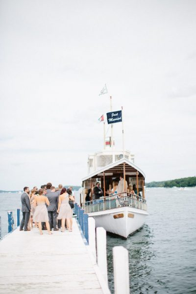 Wedding party waiting to board the steam yacht Louise