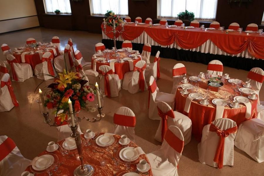 wedding reception with white and orange table linens