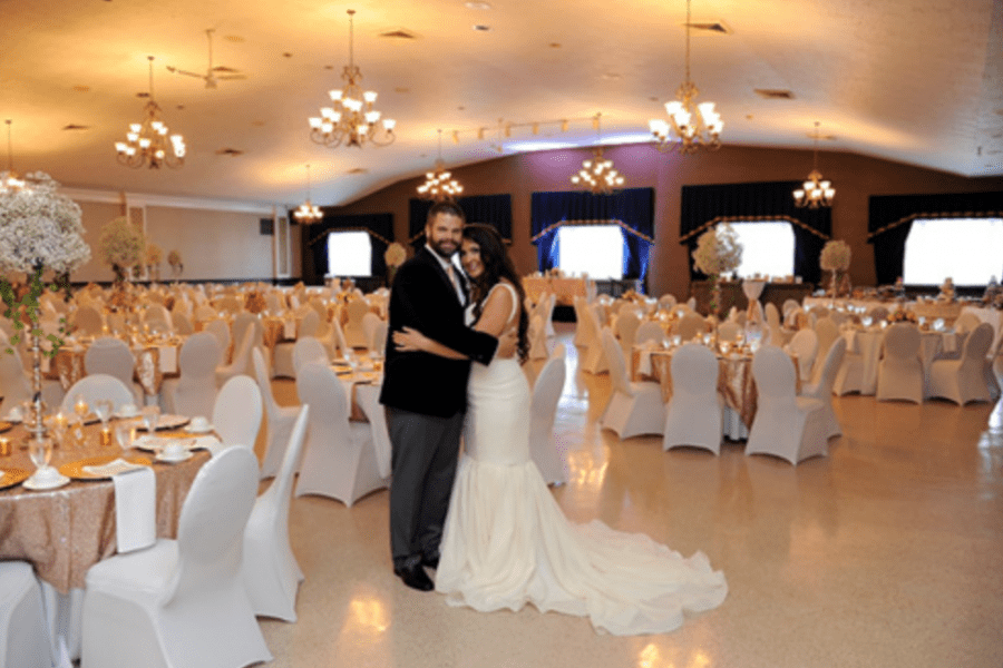Bride and groom at their wedding reception at the Tripoli Shrine Wedding Center