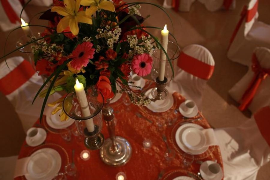 Elegant table top setting with white and burnt orange linens