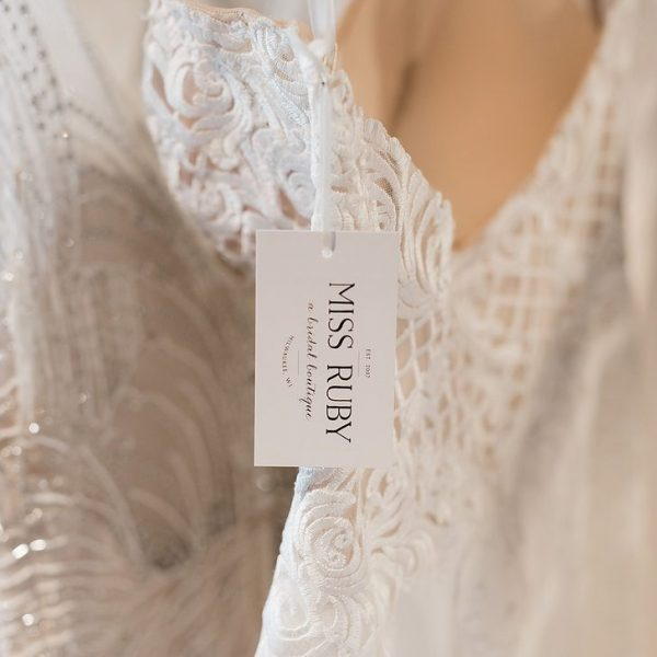 Close up of dress on hanger with Miss Ruby tag on it