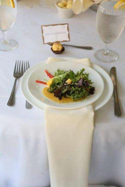 Plated salad on white tablecloth