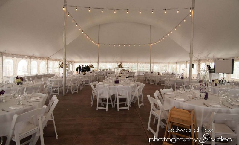 Inside of decorated wedding tent