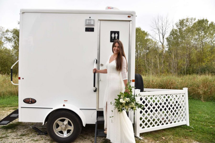 Bride entering upscale portable restrooms