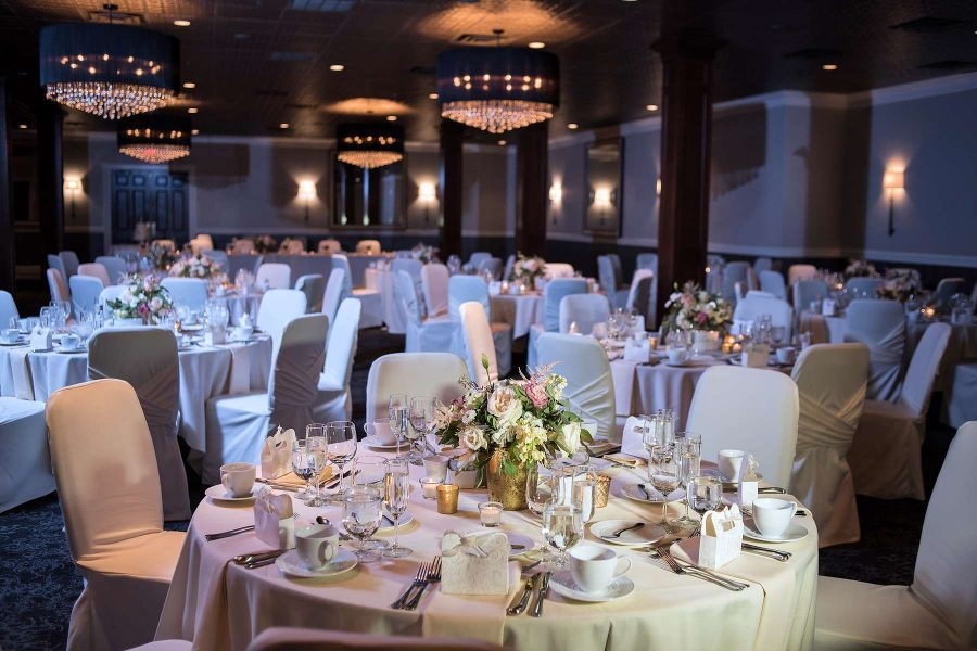 Wedding reception with white and pale pink color scheme at the Delafield Hotel