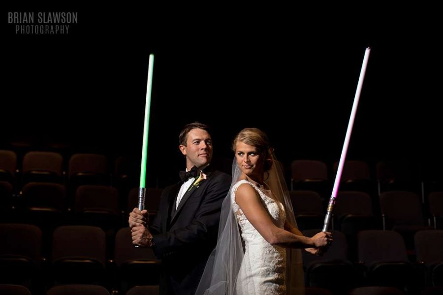 Lightsabor wielding bride and groom