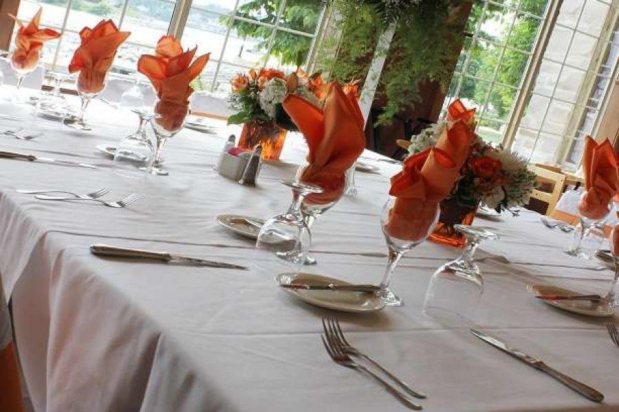 Stone Harbor Wedding Reception with orange and white linens