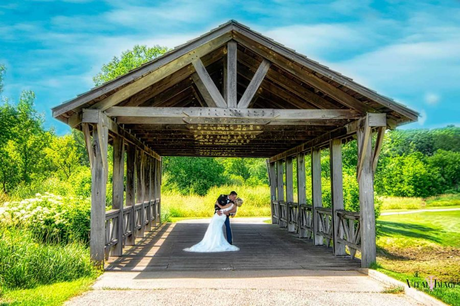 Beautiful View of Bridge with wedding couple at Hawk's View Golf Club