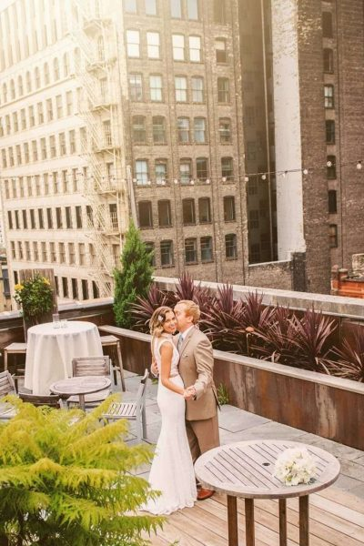 Bride Groom on rooftop terrace at the Hotel Metro in Milwaukee, WI