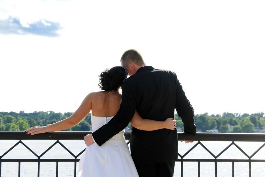 Couple newlyweds arm in arm at Stone Harbor overlooking Lake Michigan