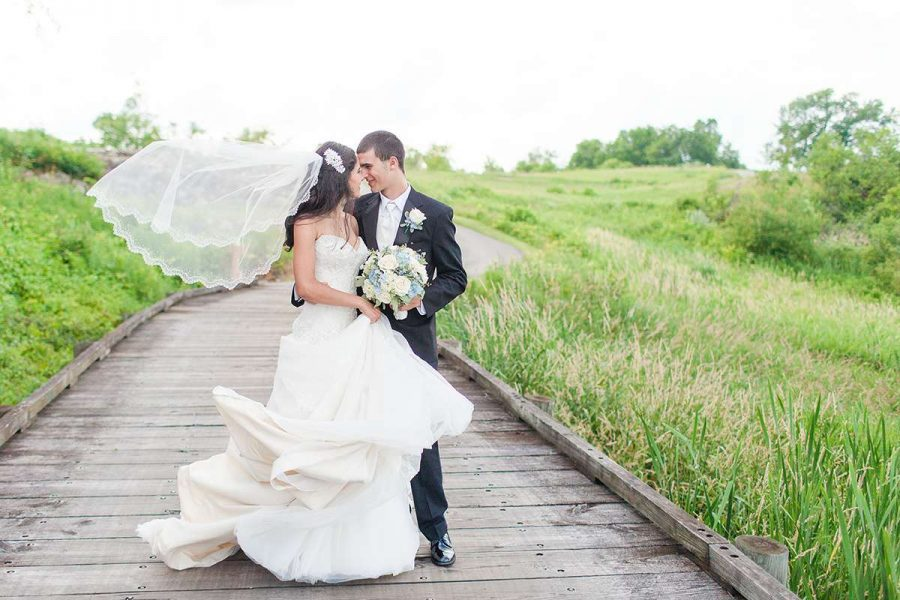 Bride and groom pose at the Bog in Saukville, WI