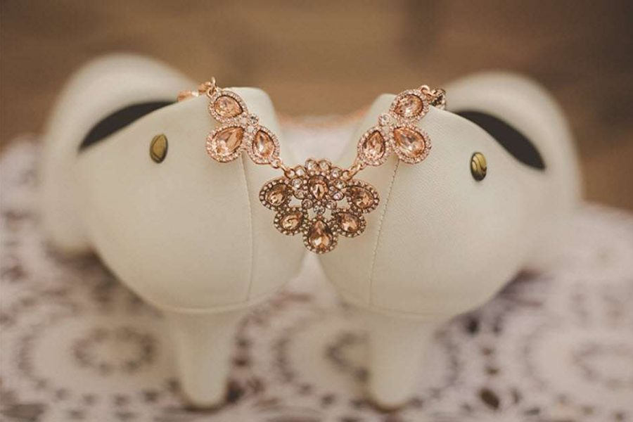 Detail image of brides shoes with her jewelry