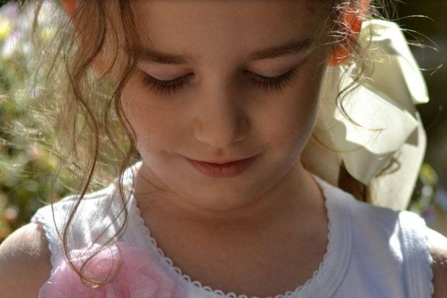Cute close up of flower girl at wedding