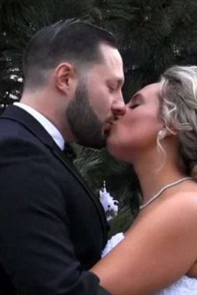 Groom kissing Bride in a special moment