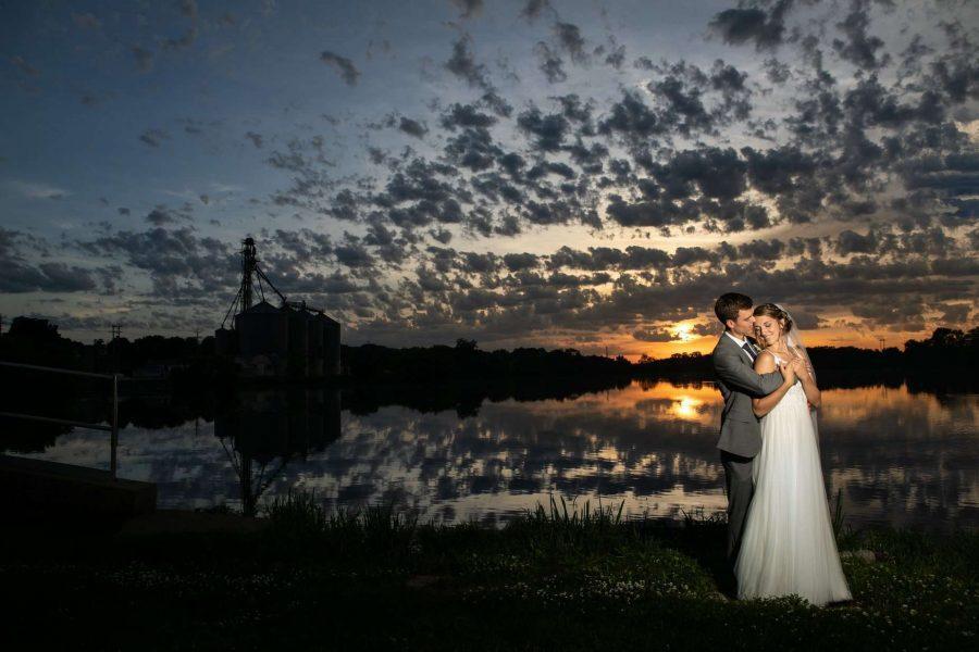 Bride and groom pose outside of Veterans Terrace in Burlington, WI
