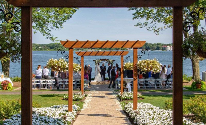 Outside lakefront wedding ceremony at Lake Lawn Resort