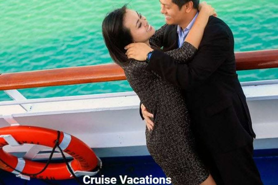 Couple on a cruise by railing