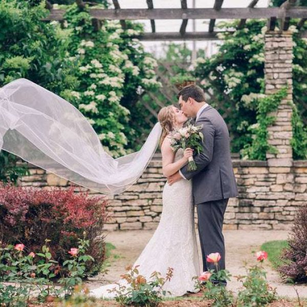 Veil flowing with wedding couple outside