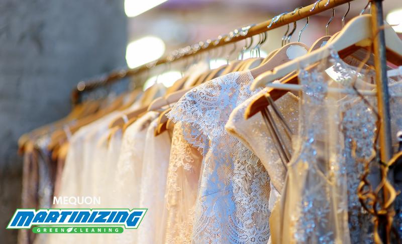 Rack of elegant wedding gowns