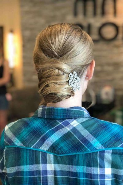 Sophisticated up-do for wedding by Merle Norman Brookfield