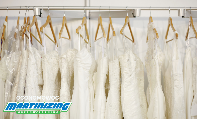 Rack of white wedding gowns