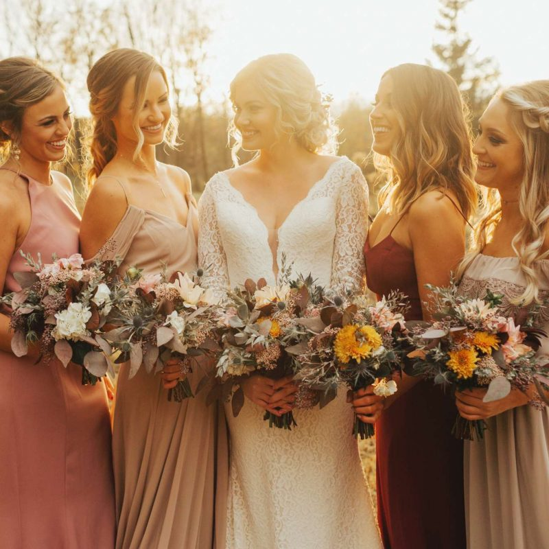 Bride with bridesmaids in fall wedding