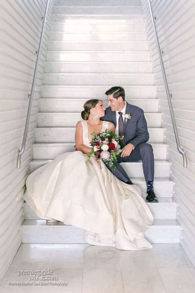 Wedding Couple Sitting on stairs at Milwaukee Art Museum