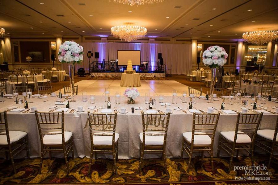 The Grand Ballroom at the Pfister Hotel beautifully decorated with high floral centerpieces