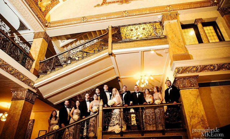 Wedding Party on Stairs for dramatic group image at historic hotel