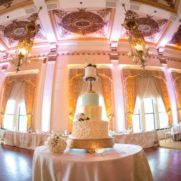 Dramatic Ballroom Wedding Reception image with cake in center