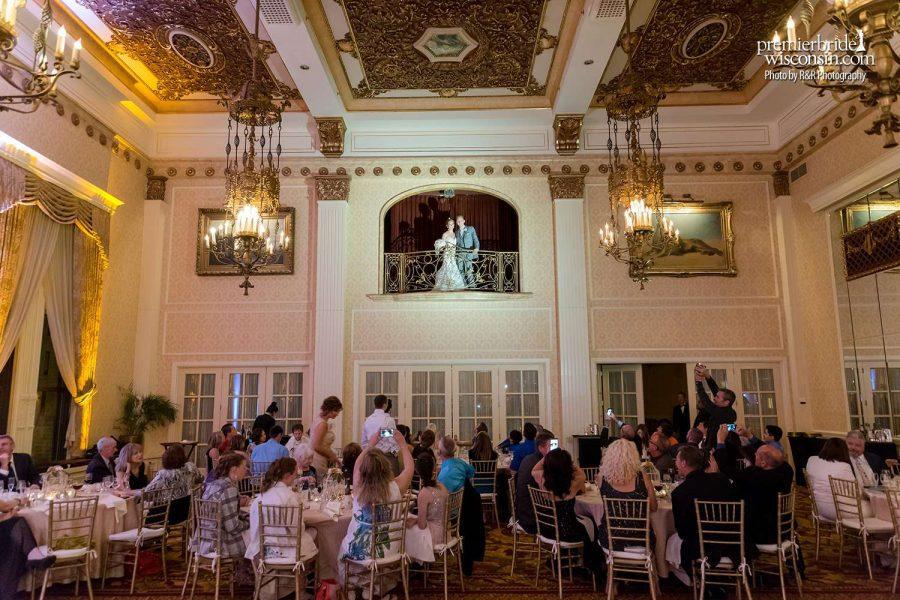 Wedding Couple overlooking guests below of wedding reception